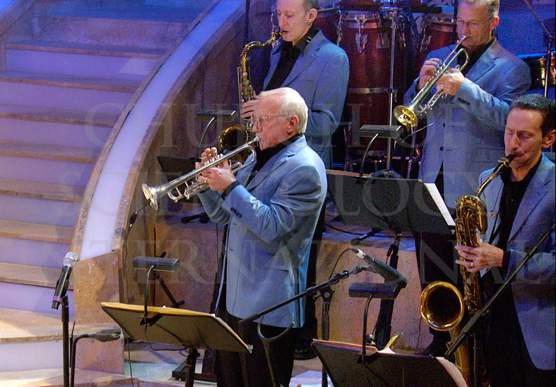 Ron Miscavige on stage playing horn