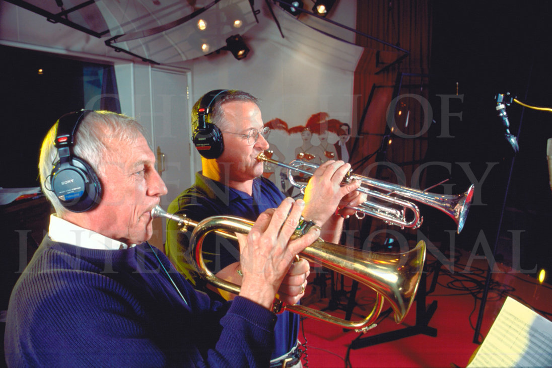Ron Miscavige in recording studio with horn