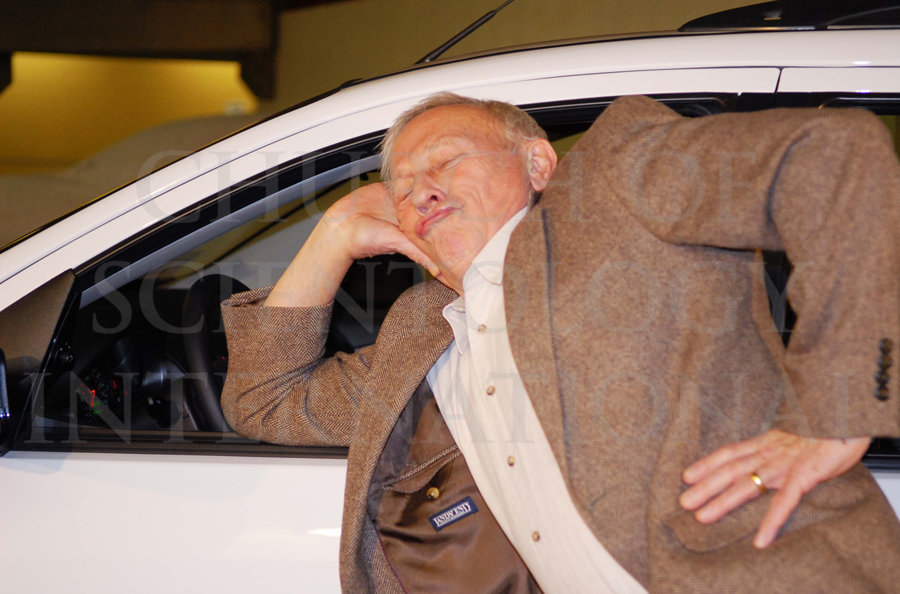 Close up of Ron Miscavige leaning on his new car