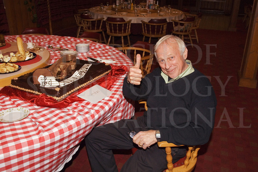 Ronald T. Miscavige at birthday party and cake with thumbs up