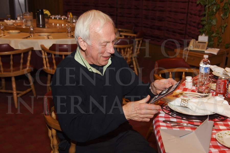 Ron Miscavige reading birthday card from COB