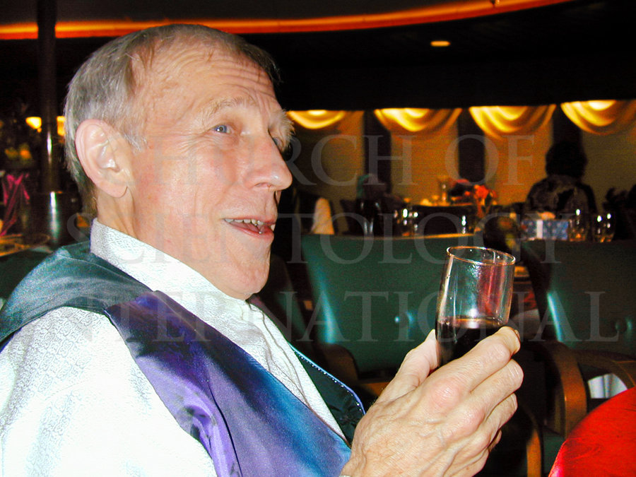 Ron Miscavige holding wine during party
